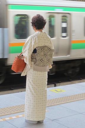 Woman in Kimono, moving train