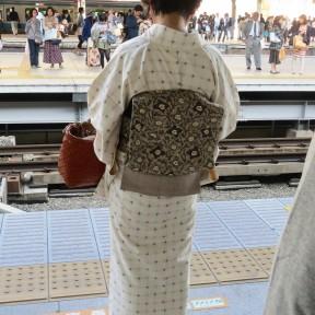 Woman in kimono, train platform