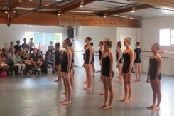 Young dancers, ensemble in black
